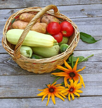 Vegetables in a basket on an old table