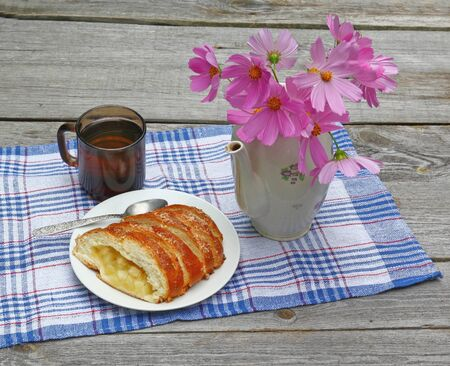 Summer still-life with apple strudel, bunch of cosmos in a teapot on the wooden table Stock Photo - 21194161