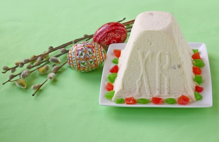 consulted: Curd paskha (pacha) , easter eggs and bunch of willow branches on a green background Stock Photo