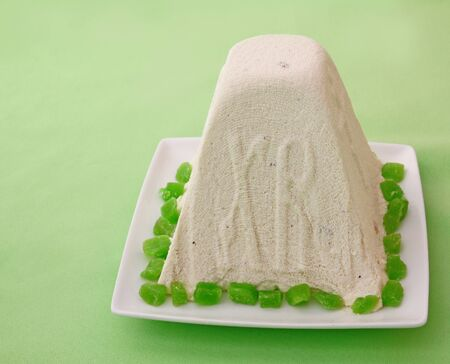consulted: Curd paskha (pacha) with green candied on a green background
