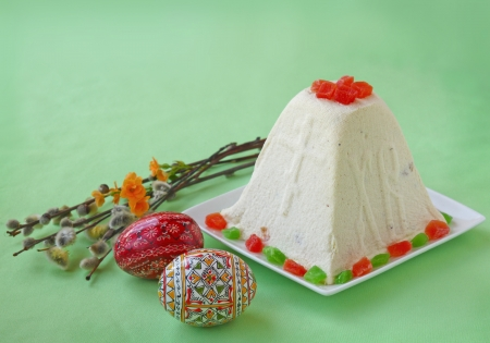 Curd paskha  pacha  , decorative Easter eggs and bunch of willow branches on a green background  Products of mass production in the the national traditions