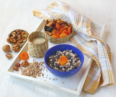 consuetude: Small basket with wheat porridge which is cooking on Christmas Eve Kutya is a traditional food on Christmas Eve. Stock Photo