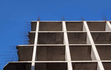Monolithic facade of block of flats under construction photo