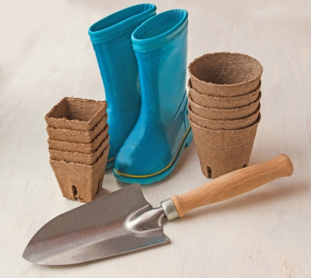 peaty: Still Life with peat pots, garden tools and rubber boots