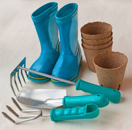 peaty: Spring still Life with peat pots, garden tools and rubber boots