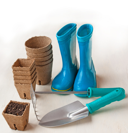 peaty: peat pots, garden tools and blue rubber boots