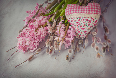 Pink hyacinth, willow twigs and  heart on a gray wooden table Stock Photo