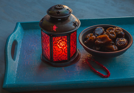 Ramadan lamp and dates on a wooden tray