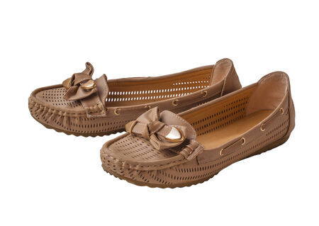 moccasins: A pair of women beige moccasins  isolated on a white background Stock Photo