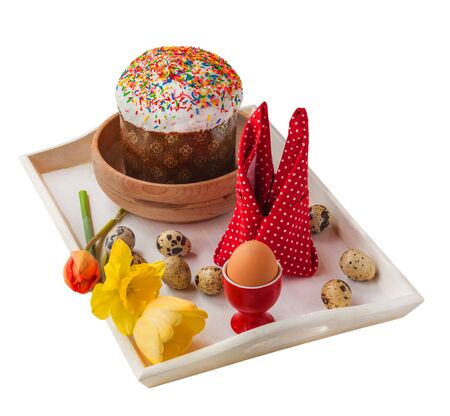 paskha: Easter still life with traditional kulich  and quail eggs on a white tray on a white background isolated