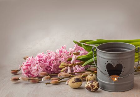 christianity palm sunday: Symbolic Easter background with branches of willow, eggs and burning candle Stock Photo