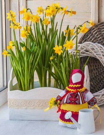 flower boxes: Flower boxes on the balcony with daffodils and doll-motanka