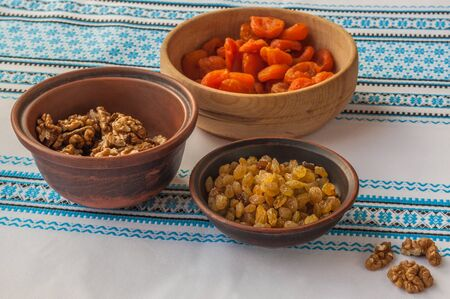 consuetude: Ingredients for kutja (nuts, raisins, dried apricots) on embroidered tablecloth Stock Photo