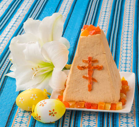 consulted: Traditional curd Easter cake on embroidered tablecloth next to the white flower and eggs Stock Photo