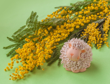 yeanling: Easter background with mimosa and lamb figurine (mass produced)