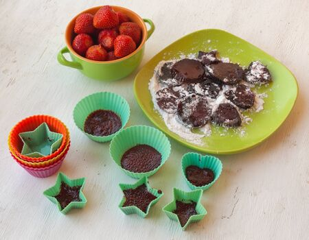 sweetstuff: Cooking pastilles of strawberries in silicone bakeware on the kitchen table Stock Photo