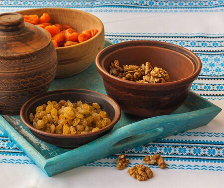 Ingredients for kutja (nuts, raisins, dried apricots) on embroidered tablecloth Stock Photo