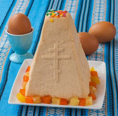 consulted: Traditional curd Easter cake on embroidered tablecloth next to the Easter eggs