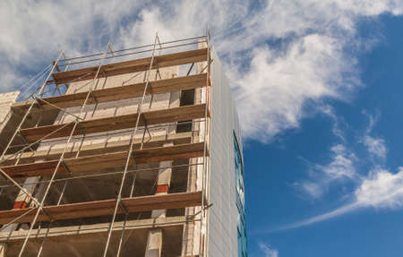 concrete commercial block: Construction of the new building is completely made of glass Stock Photo