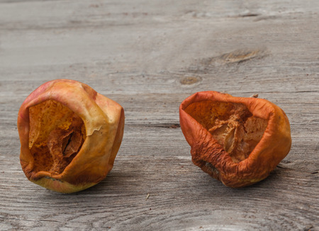 sicken: Fruit of the apple eaten by wasps on a wooden background