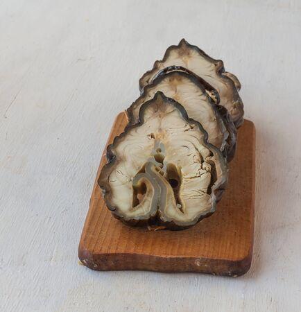 sturgeon: Pieces of smoked sturgeon on a cutting board Stock Photo