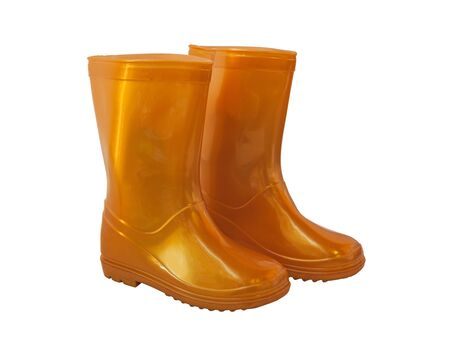 galoshes: Golden-yellow glistening rain boots on a white background isolated