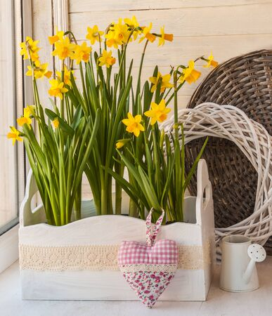 decorative balcony: Daffodils in the balcony boxes next to the decorative watering can and heart