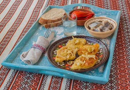 polish lithuanian: Dish Lithuanian, Polish, Belarusian cuisine rhombuses potato with fried onions on the tray