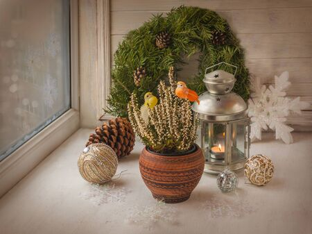 christmas decor: Christmas decorations  in the window on the eve of Christmas (products of mass production)