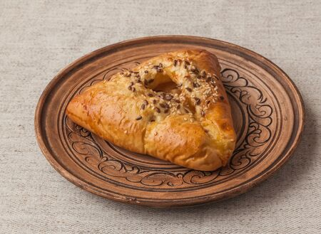 sesame street: Open bun with meat and onions on a clay plate, Ukrainian dish of the Crimean Tatar and Eastern cuisine Stock Photo