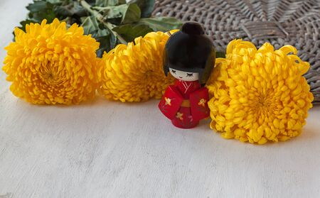 ninth: Concept of a Japanese holiday chrysanthemums ninth of the ninth lunar month of the traditional Japanese doll Kokeshi (mass production)