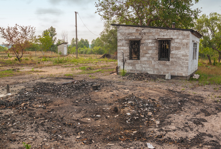 ruinous: The charred ruins and remains of a burned down house near the road