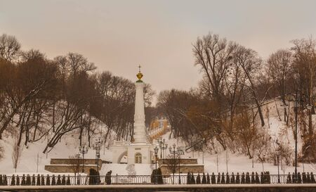 baptizing: KIEV, UKRAINE - JAN 22, 2016: Monument to Magdeburg Rights among other names there are Column of Magdeburg Rights, Baptizing of Ruthenia Monument,  Lower Monument of  Saint Volodymyr in Kiev Ukraine