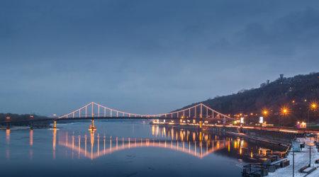 KIEV, UKRAINE- DEC 25, 2016: Pedestrian bridge across the Dnieper Trukhanov Island on the evening, Kiev, Ukraine Editorial