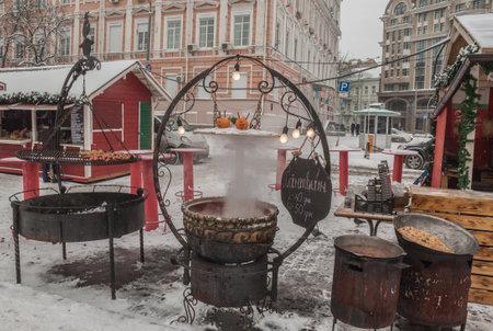 festivities: KIEV, UKRAINE-Jan 7, 2017: Hot mulled wine and snacks in the Christmas festivities on St. Sophia and St. Michaels Square in Kiev, Ukraine.