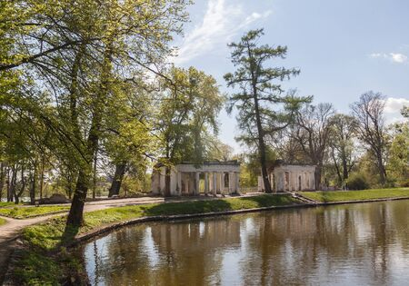 UKRAINE, BELAYA TSERKOV - APRIL 18, 2016: Pavilion Ruins over the waterfall in Bath Pond in the Park of Alexandria in Belaya Tserkov, Ukraine