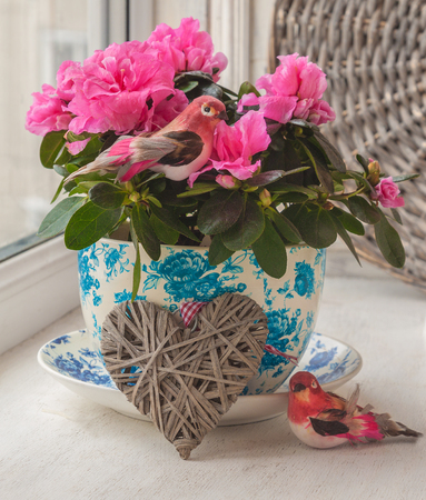 Window Decoration with pink azaleas and birds and hearts for the holiday Valentines Day
