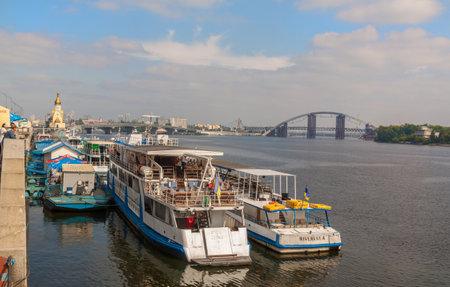navigable: KIEV, UKRAINE - SEPTEMBER 5, 2015: Tourist boat sails on the river quay in Kiev on a tour of the Dnieper, Kiev, Ukraine