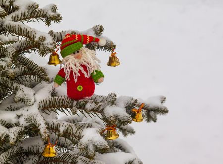 dwarf christmas: Merry Gnome and bells  on the Christmas tree. Mass production