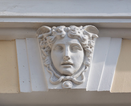 facilitate: Mascaron in the historic building of the XIX century in Kiev