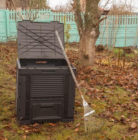 sagacious: Black plastic composter  in autumn  garden.
