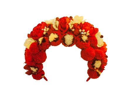 Traditional Ukrainian wedding wreath made of artificial flowers made from fabric and wax and woolen pompoms on a white background isolated