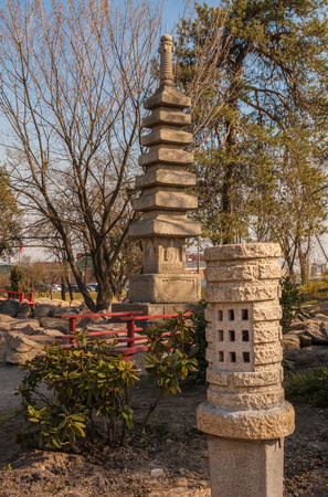 Oriental lantern in a stylized Japanese park in the spring