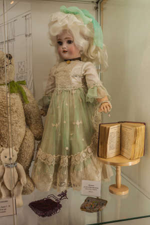 Kyiv, Ukraine - February 5, 2020: An ancient vintage doll and  bear 19 cent. in the Toy Museum, Kyiv, Ukraine