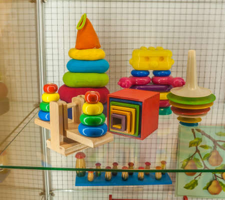 Kyiv, Ukraine - Feb 5, 2020: Wooden and plastic didactic toys  for development of logic and motor skills in the Toy Museum, Kiev, Ukraine