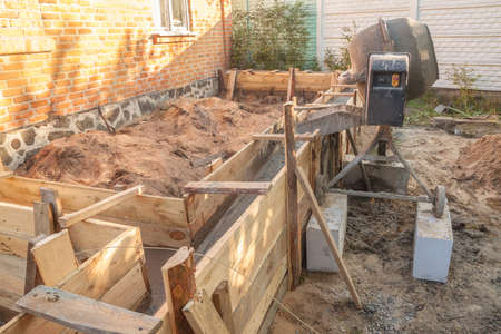 Pouring the foundation for the veranda for an extension to the country house Standard-Bild