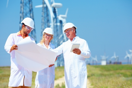 energy work: scientists discussing project on wind power station Stock Photo