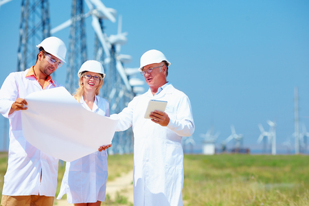 scientists discussing project on wind power station photo