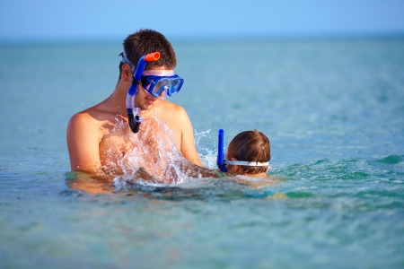 happy father and son snorkeling photo