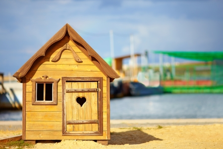 cute children playhouse near the lake Stock Photo